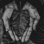 Old person's hands holding leaf